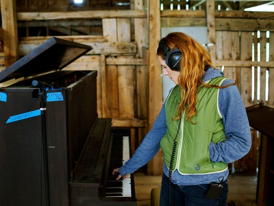 Neko Case plays a piano at her barn near St. Johnsbury
