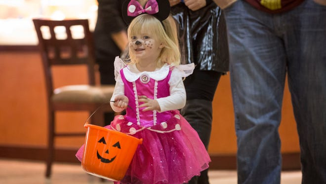 Trick-or-treaters from across the community go door to door collecting candy on Oct. 31 for Halloween. Hundreds of kids in costume from across the area took part to fill their bags full of candy.