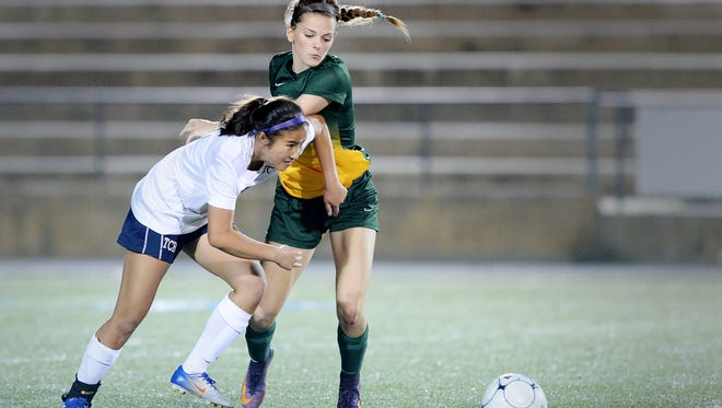 Roberson's Mazie Hughes, left, and Reynolds' Clara Kintner battle for a ball Tuesday night in Skyland.