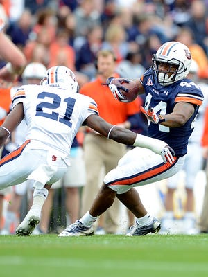 Auburn defensive back Mackenro Alexander (left) is leaving the program.
