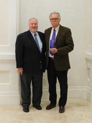 Michael Kint, United Way CEO and Tom Manwaring, Ralph T. King Award winner.