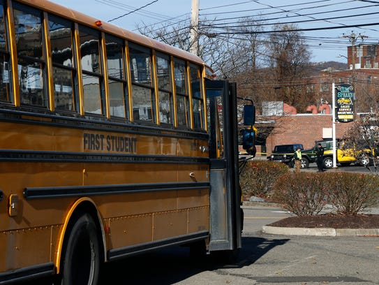 A First Student school bus in a parking lot off  Main