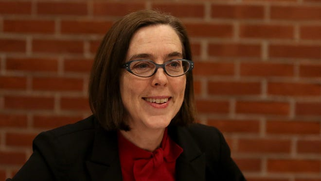 Kate Brown, Oregon Secretary of State, talks with editorial staff at the Statesman Journal on Tuesday, Feb. 3, 2015, in Salem.
