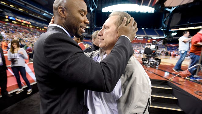 MSU head coach Tom Izzo, right, shares a moment with former Spartan standout Mateen Cleaves after MSU's  practice in Indianapolis Friday  4/3/2015.