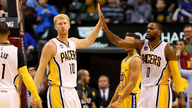 Indiana Pacers forward Chase Budinger (10) is congratulated by teammate C.J. Miles (0) during the game against the Golden State Warriors at Bankers Life Fieldhouse on Dec. 8, 2015.