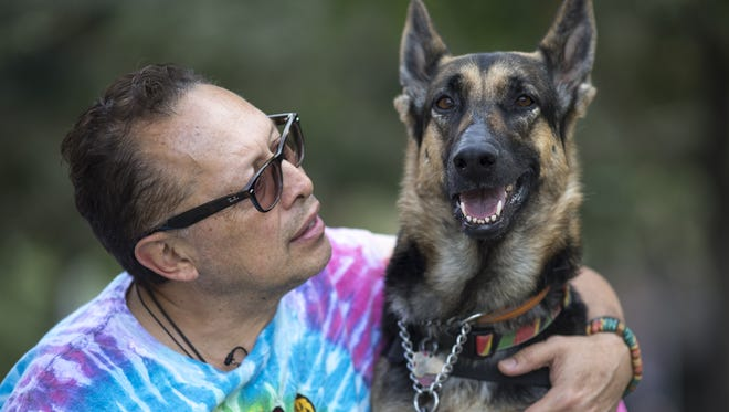 Patricio Espinoza and his service dog, Frida, on Oct. 31, 2016, at the Downtown Civic Space Park, 424 N Central Ave., Phoenix.