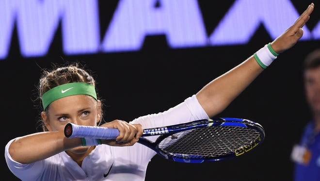 Belarus's Victoria Azarenka gestures as she celebrates after victory in her women's singles match against Belgium's Alison Van Uytvanck on day two of the 2016 Australian Open tennis tournament in Melbourne on January 19, 2016.