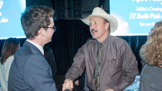 In this March 18, 2017 file photo, congressional candidate Rob Quist meets with supporters during the annual Mansfield Metcalf Celebration dinner hosted by the state's Democratic Party in Helena, Montana.