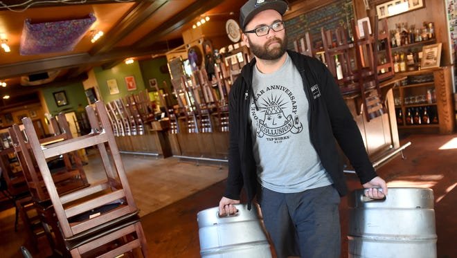 Andrew Hurst, a cellarman with Collusion Tap Works carries empty kegs out of the storage area of the Holy Hound Taproom during local deliveries around York on Thursday, Oct. 19, 2017.