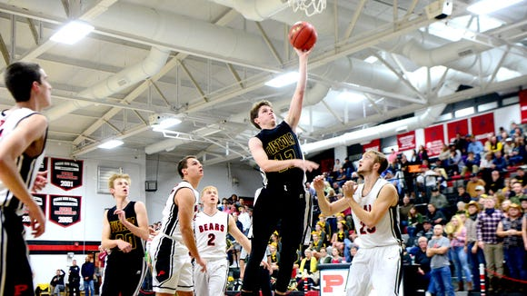 Tuscola's Davis Reynolds goes up for a shot against