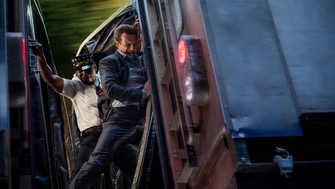 "Michael (Liam Neeson) shows off his skills in ""The Commuter."""