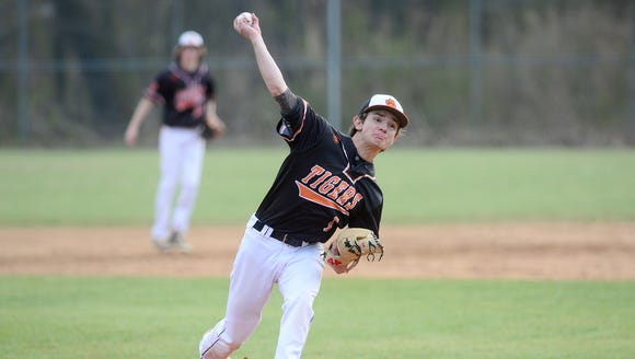 Rosman pitcher Tyler Owen throws a pitch during their
