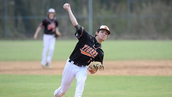 Rosman pitcher Tyler Owen throws a pitch during their game against Murphy at Rosman High School on Friday, March 16, 2018. The Bulldogs defeated the Tigers 18-3 in five innings.
