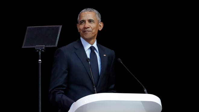 Former U.S. President Barack Obama, left, delivers his speech at the 16th Annual Nelson Mandela Lecture at the Wanderers Stadium in Johannesburg, South Africa, Tuesday, July 17, 2018.