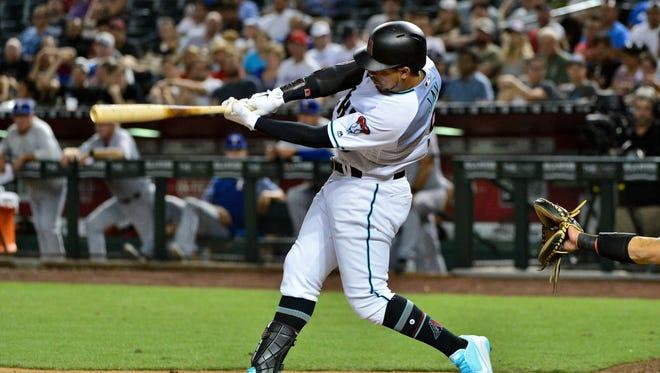 Jul 31, 2018: Arizona Diamondbacks center fielder Jon Jay (9) hits an RBI single in the fourth inning against the Texas Rangers at Chase Field.