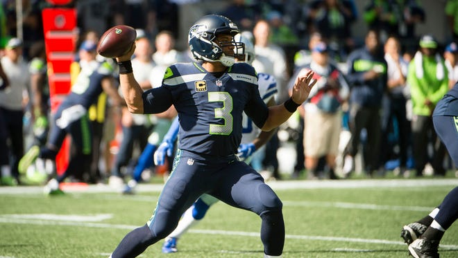 Seattle Seahawks quarterback Russell Wilson (3) throws a pass during the first half against the Dallas Cowboys at CenturyLink Field.