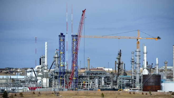 Construction cranes at Calumet Montana Refining in Great Falls in early March 2015.