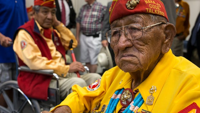 Navajo Code Talker Dan Akee (right) at the Arizona State Capital on July 16, 2014. Looking on is Navajo Code Talker Peter MacDonald.