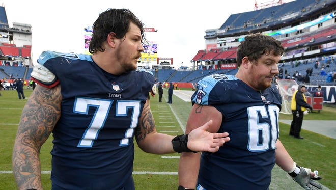 Titans offensive tackle Taylor Lewan (77) and center Ben Jones (60) walk off the field after the team's loss to the Rams at Nissan Stadium Sunday, Dec. 24, 2017 in Nashville, Tenn.