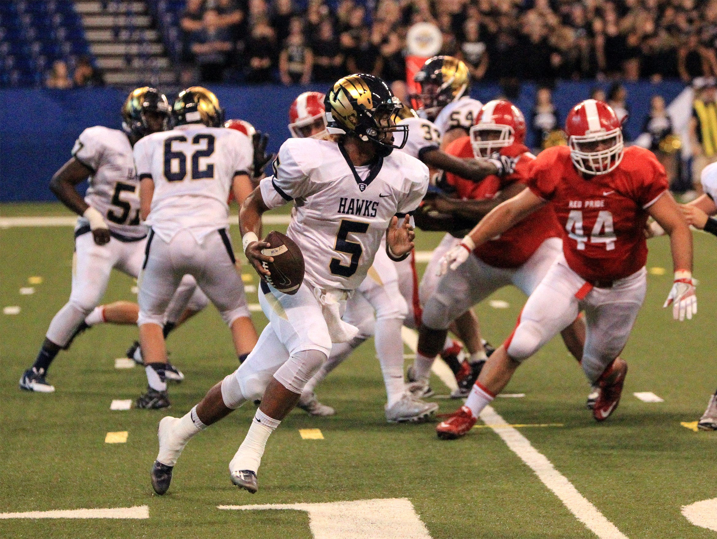 Decatur Central quarterback Bryce Jefferson breaks away from the Plainfield Quakers defense at Lucas Oil Stadium. He threw for a touchdown and ran for one Friday, Sept. 23, 2016.