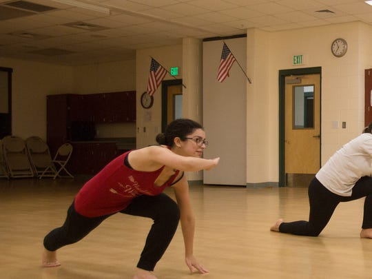 Capoeira students Diana Celeste Torres and Cassandra Biscardi follow the instruction of James Green III, an 11-year veteran of the art.