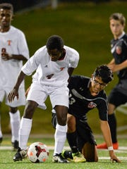 Rocori's Alex Aviles (13), right, goes to the ground