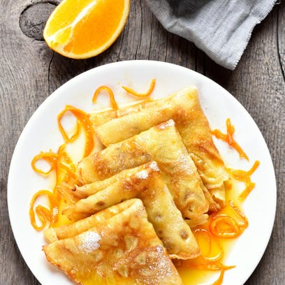 Crêpes suzette are finished with an orange sauce. They can be part of a special menu for Mother's Day.