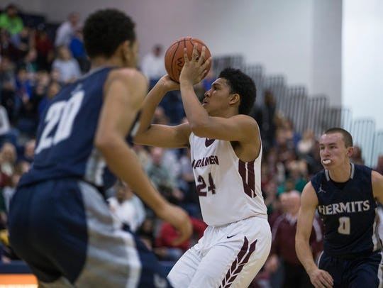 Don Bosco's Ronald Harper takes a clear shot during