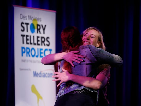 "Elle Wignall hugs storytelling coach Courtney Crowder Thursday, April 5, 2018, during the Des Moines Storytellers Project's show called ""Busted: Stories of When I Got Caught"" at the Temple Theater in Des Moines."