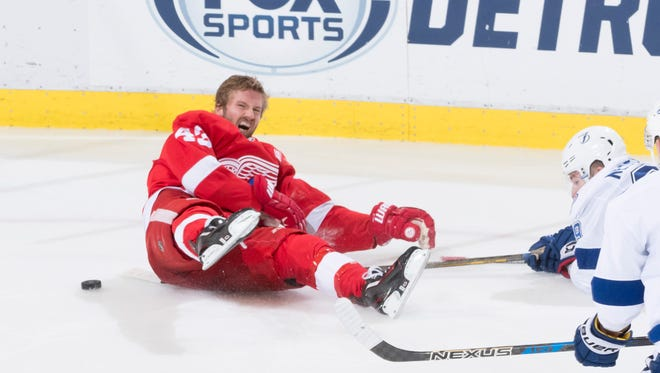 Detroit center Darren Helm reacts after a collision with Tampa Bay defenseman Nikita Nesterov in the third period on Nov. 15.