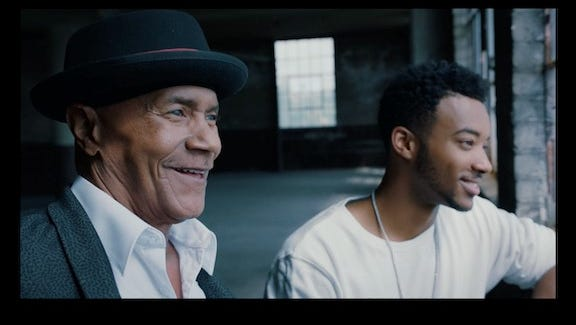 """Former Dramatics member Larry Reed (left) and the actor who plays him the film """"Detroit,"""" Algee Smith"""