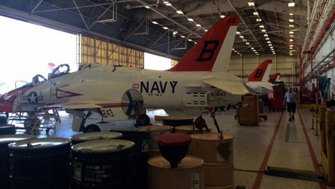 T-45 Goshawk jets line up in July 2016 in a maintenance hangar at Naval Air Station Kingsville, Texas.