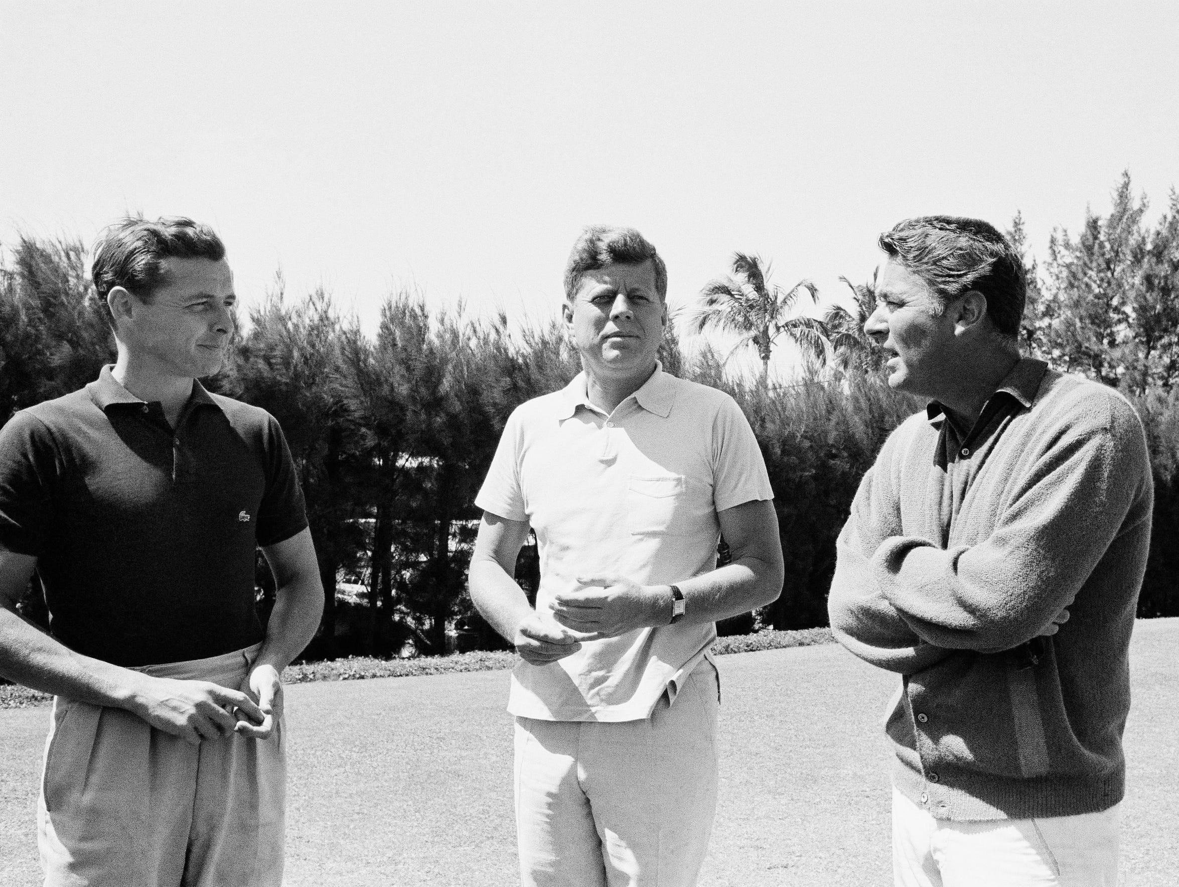 President John Kennedy, clad in a sport shirt and slacks,