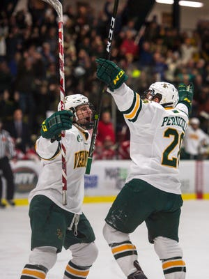 The University of Vermont's Anthony Petruzzelli, right, celebrates his goal against Boston University with Tom Forgione in Burlington on Friday, December 8, 2016.