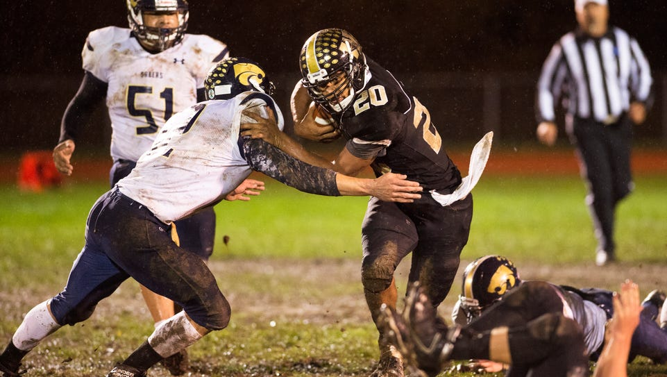 Windsor running back Dante Kimbrough is tackled by