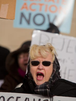 Sally LaVaugh shouted in unison with other protesters