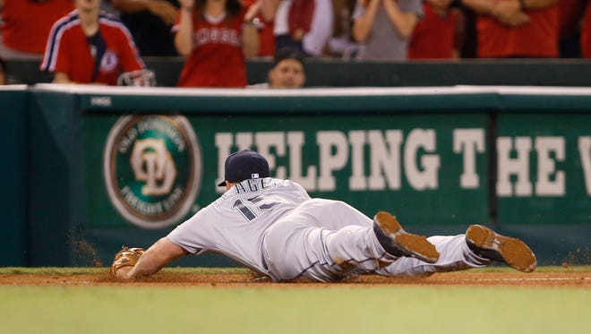 Seattle Mariners' third baseman Kyle Seager stops a ball hit by Los Angeles Angels' Andrelton Simmons before throwing him out at first base to end the game and give the Mariners a 4-3 victory in the bottom of the ninth inning of a baseball game, Wednesday, Aug. 17, 2016, in Anaheim, Calif.