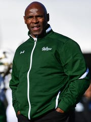 South Florida coach Charlie Strong watches from the