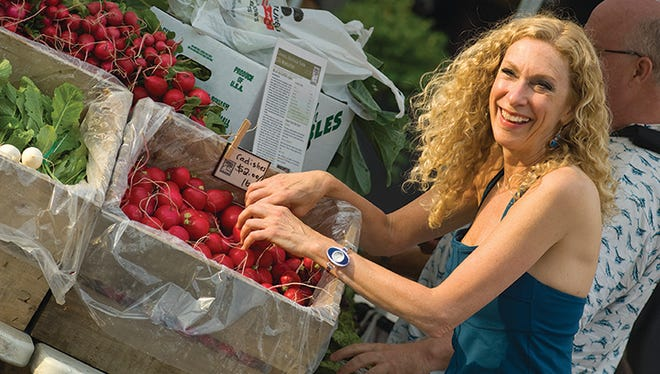Sheree Clark shopping at the local Farmers Market.