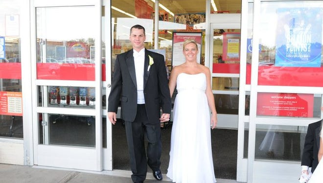 Having met when they were co-workers at the Garden City Kmart, Joe and Kristin Bandy stopped by the store for a visit following their wedding reception.