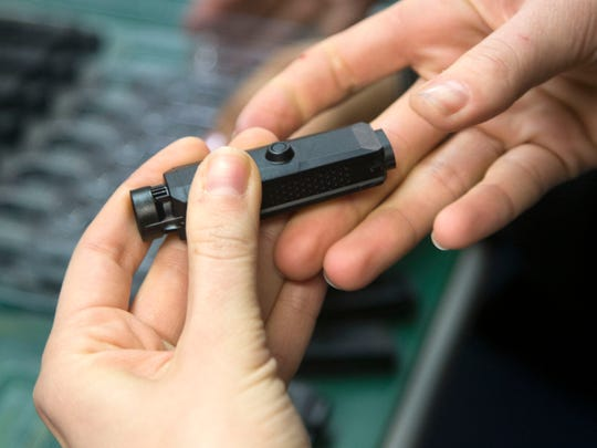 An Axon Flex 2 body camera is inspected for quality