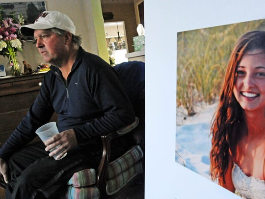 James Holleran, father of Madison Holleran,  talks about his daughter while sitting next to a favorite photo of her at his home in Allendale in 2014.