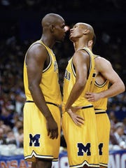 Michigan's Chris Webber, left, and Jalen Rose talk