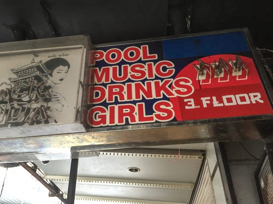A sign for a bar in the Patpong red light district in Bangkok, Thailand.