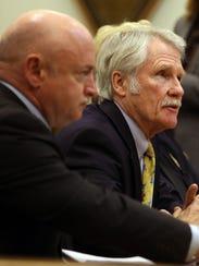 Mark Kelly, left, and Gov. John Kitzhaber testify in