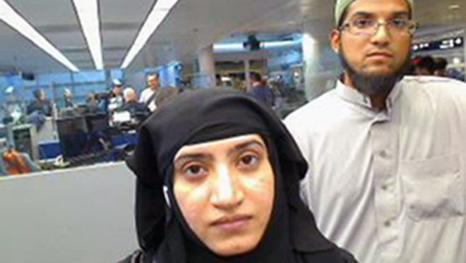 This July 27, 2014 file photo provided by U.S. Customs and Border Protection shows Tashfeen Malik, left, and Syed Farook, as they passed through O'Hare International Airport in Chicago.