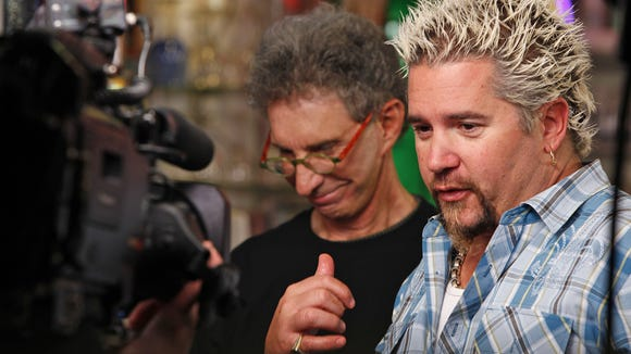 Guy Fieri in 2010 sampled a burger at Terry's Turf Club in Linwood made by owner Terry Carter (left).