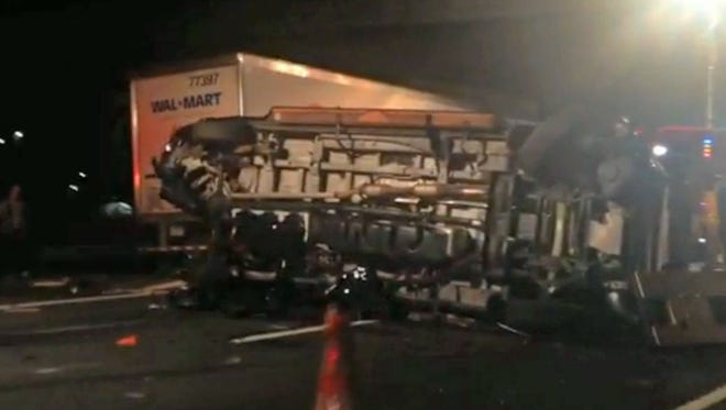 In this image from video, the limousine bus carrying Tracy Morgan and six other people lies on its side early Saturday morning on the New Jersey Turnpike. Morgan remained hospitalized as state and federal officials continued their investigation of the six-vehicle crash on the New Jersey Turnpike that took the life of a Morgan friend and left two others seriously injured, authorities say.