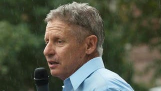 Gary Johnson talks with supporters.