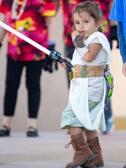 "Eliana Moya, 4, dressed as Rey from ""Star Wars"" on Saturday, April 14, 2018 during Las Cruces Space Fest's Space Walk down Main Street."